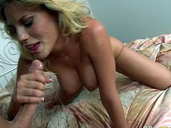 Torrid blonde wench with big boobs gives deepthroat blowjob. She actually gets face fucked brutally. Later on she is penetrated in her wet pussy hole in a missionary sex position.