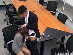Sometimes a meeting at work can be tiring but our Nippon cutie knows what's next after a meeting. She remains in the room and her colleague gives her a well deserve cock in her mouth. After such a hard day of work this cute bitch deserves a dick between her sweet lips and loads of cum.