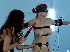 The extreme bondage session where Audrey Hollander is blindfolded and strapped, has her electrically tortured by Gia Dimarco.
