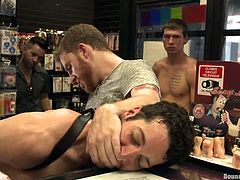 This guy stepped in a sex store, to find a sex toy for sexual satisfaction, but he found a lot more, than sex toys inside it. A few horny gay males, were waiting for such a cutie and soon, he ended up naked and ass fucked. The guys tied his hands, bent him over and fingered his asshole, before brutally fucking him