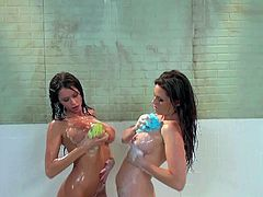 Emily Addison and Allison Moore are sexy wet babes that have lesbian sex in the shower. They admire each others juicy boobs and round asses before it comes to pussy licking. They love doing it.