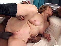 Madly horny granny is serving three black studs in hardcore interracial gangbang session. So she sucks two BBCs while riding another one.