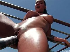 This fucking machine runs on gas and that is why Charley Chase uses it outdoors. Babe sweats so bad, when it drives deep in her hot pussy!
