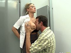 Busty blonde MILF squeezes big dick between her twins while sitting on a toilet pan in a restroom. She then gets her wet pussy finger fucked upskirt.
