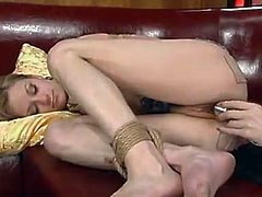 Horny chick gets her tits stimulated with electricity and pussy toyed with electric dildo. After that she also gets tied up and drilled with another dildo by a girl.