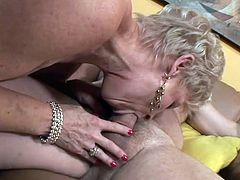 Granny Champagne needs to fuck, so her old fart Buck is there for her. He licks her shaved pussy and makes her moan, like a old whore, before she sucks his dick. Yeah, granny likes the feeling of a cock in her mouth and while she sucks it, she wonders how much Buck will cum