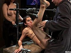 Brunette dominatrix Isis Love is having fun with Princess Donna Dolore in a basement. Isis binds and torments Donna and then destroys her holes with a strapon.