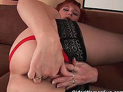 Older Woman Fun brings you an amazing free porn video where you can see how a horny mature redhead in black stockings fists her cunt while assuming very hot poses.
