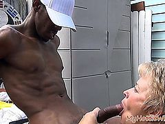 Hot sexy mature lady sucking muscle's boy cock