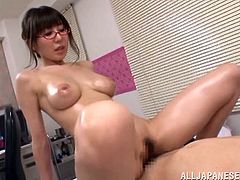 Japanese bombshell Meisa Chibana pleases some guy with a handjob. Then she oils her fantastic big natural tits and they fuck in cowgirl position and doggy style.
