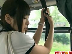 Yuu Asakura is standing in the bus. A guy lifts her skirt and starts to jerk off his cock until he cums on her ass cheeks.