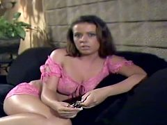 Charming dark-haired chick Penny Flame is sitting on a sofa in the living room. She answers some questions and tells about her job and then demonstrates her sweet tits.