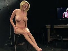 Blonde cutie Krissy Lynn is getting naughty with some guy in a basement. She lies down on the floor and lets the dude tie her up before he rubs her pussy with a dildo.