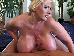 Damn, this girl really got some too huge boobs! She oils herself and him up to enjoy his huge cock in her wet beaver! hard to make Kayla Kleevage stun!