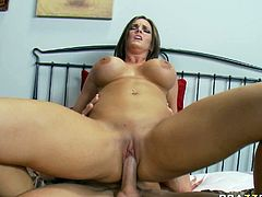 Curvaceous brunette bombshell Mackenzee Pierce lies on a bed with her legs wide open. She is penetrated in her wet pussy hole in a missionary position. Horny dude probes her pussy deep.