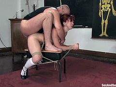 Bad student Trinity Post is having fun with her lewd teacher Mark Davis in a classroom. Martk binds the slut, plays with her twat and then fucks it as hard as he can.