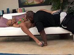 Horny black bitch teases her mate by showing off her classy black booty in red thongs. Dude eats her soaking poontang and gets his hose polished.