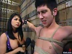Naughty Asian girl in sexy dress ties Danny Wylde up and rides a dildo fixed to his mouth. Later on she whips and toys his ass.