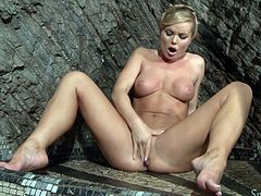 Stunning blonde MILF shows her perfectly shaped body while taking a shower. Then she sits down on the floor and starts to finger her smooth pussy.