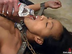 Tied up Asian girl gets gagged and whipped painfully. Later on she gets her pussy drilled by a fucking machine.