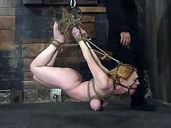 Blonde chick strips her clothes off. Then she gets hog tied and gagged. Later on the master twists her boobs with ropes.