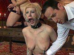 Bella Rossi and Cherry Torn in hot bondage video. The busty blonde gets tied up and then clothespinned. Her master also puts a spider mask in her mouth.
