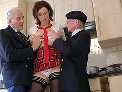 Hot schoolgirl enjoys two old males banging her shaved holes in wild threesome