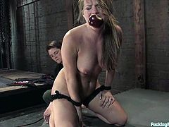 In this bondage session the blonde girl Harmony is going to get double penetrated by a machine while her clit is rubbed by a vibrator.