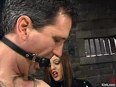 Poor guy gets his balls and dick twisted with ropes. After that his crazy mistress drills his ass with a strap-on.