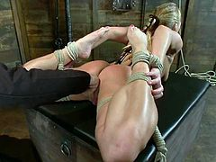 Naughty Aurora Snow gets tied up and undressed. Later on the guy puts her on a chair and toys her vagina.