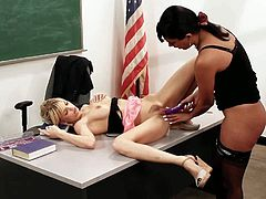 Slender natural blonde schoolgirl Jana Jordan with soft milky skin and tight ass gets shaved cunny stuffed with toy by black haired Shazia Sahari in stockings on desk in classroom.