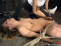 Leah Luv gets bound by some dominant chick in a basement. Leah gets her pussy drilled by a fucking machine and then moans loudly while being fist-fucked.
