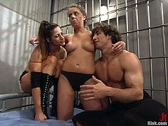 It's a femdom threesome with two police officers, Kym Wilde and Penny Flame, strapon fucking an inmate in jail.