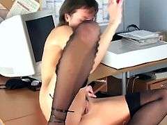 Skinny brunette amateur is wearing her sexy stockings and spreads legs in the office. She rubs her clit and toys her pussy for a nice orgasm!