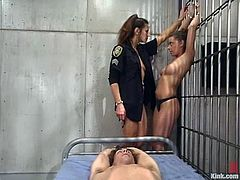 This bitchy and such a cruel police office is going to torture this dude together with her sexy and busty assistant! BDMS Femdom is going on in cell!