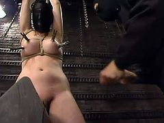 Sassy blond babe gets tied up on the wall and her legs are spread wide with ropes. Sgt. Major has a full possession over her twat!