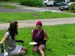 Appealing women with stunning bodies are looking sextractive wearing fancy dresses. They are having lunch on a loan outdoor. They both get a bit messy with ketchup.