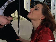 Voracious redhead bitch takes hard dong of her boss deepthroat. She then bends over the couch lifting up her black mini skirt. She is gets stuffed with fat cock in her ass from behind.