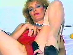 Have the pleasure of watching this horny mature blonde pleasing herself with toys after taking off her clothes in this vintage clip.