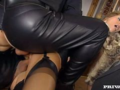 Sex hungry chick in black corset sucks cocks of two men in black suits. Later they double penetrate her and make her moan of pain and pleasure.