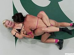 Blonde girl gets a win over Asian chick in Ultimate Surrender battle. So, Tia Ling gets her vagina drilled with a strap-on by Vendetta.