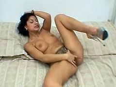 A sexy exotic MILF is going to play with herself, fingering her snatch with lust and passion, eager to reach many orgasms.