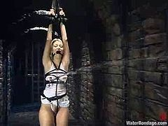 Kimberly Kane gets undressed and tied up with ropes. After that the mistress drills Kimberly's vagina deep and hard in water bondage video.