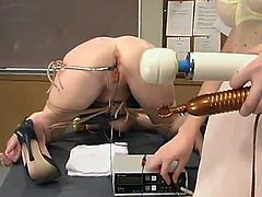 Hot chick gets tied up and blindfolded. After that she gets her wet pussy toyed deep and hard with an electric dildo and a fucking machine.