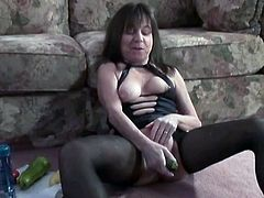 Flabby mommy wearing black pantyhose is single. So she has to fuck her loose twat with huge cucumbers and squash in order to please herself.