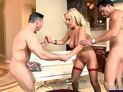 Lustful blonde slut wearing red stockings gets her pussy and anus double penetrated. Be pleased with hot and exciting threesome DP sex tube video.