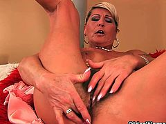 Watch this sexy and hot granny Renata in this hot solo video where you will see her stripping off her clothes and showing you her hairy cunt and that juicy ass.Watch as she spreads her legs and toys her hairy pussy in the bed with dildo.