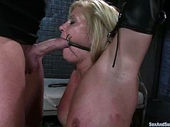 Lewd blonde Ginger Lynn is having fun with Mark Davis in a vault. She lets the man tie her up and then enjoys having his schlong in her mouth and tight butt.