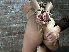 The girl in this video is the Japanese Yuki Mori and she's going to get her throat fucked and her pussy toyed while she has a bag on her face and she's tied up.