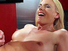 Lusty young looking blonde milf Darryl Hanah with nice natural tits and big provocative tattoo on lower back gets wet shaved twat and round bouncing ass fucked by Eric John.